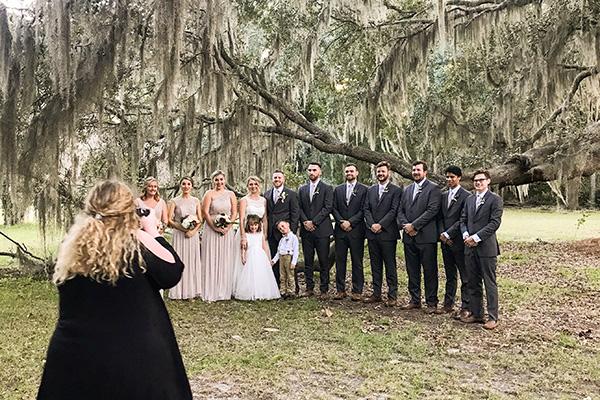 Wedding photographer taking photos of a wedding party at Hewitt Oaks