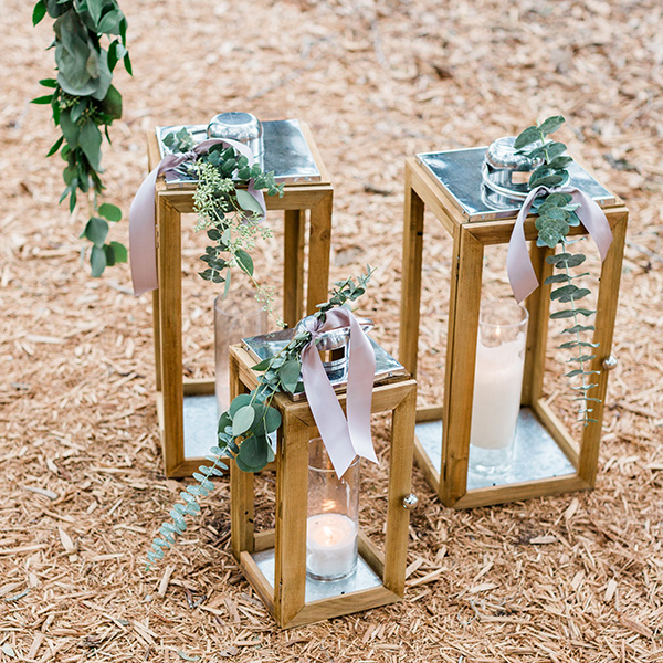 Wood lanterns with ribbon and greenery